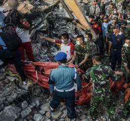 Indonesian military plane crashes into house killing 4