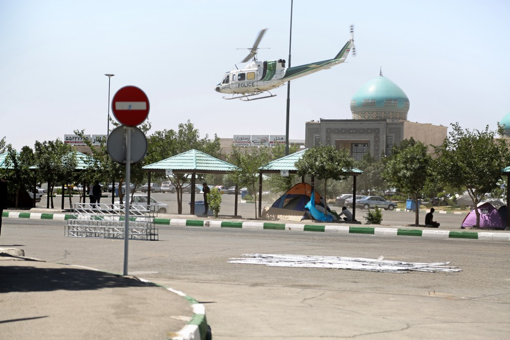 TEHRAN, IRAN - JUNE 7: A helicopter belongs to Iranian police patrols at the site after gunmen opened fire at Iran's parliament and the shrine of Ayatollah Khomeini in the capital Tehran, Iran on June 7, 2017. ( Hasan Shirvani - Anadolu Agency )
