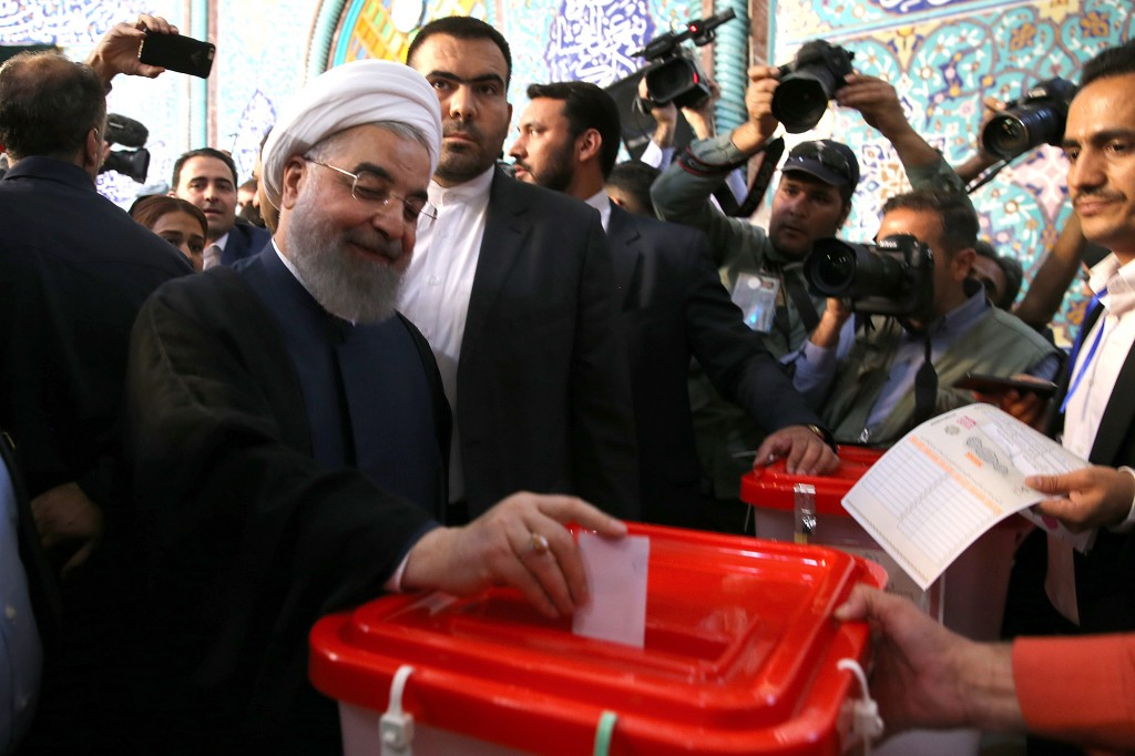 "TEHRAN, IRAN - MAY 19: (----EDITORIAL USE ONLY – MANDATORY CREDIT - ""IRANIAN PRESIDENCY / HANDOUT"" - NO MARKETING NO ADVERTISING CAMPAIGNS - DISTRIBUTED AS A SERVICE TO CLIENTS----) Iran's current President and presidential candidate Hassan Rouhani casts his ballot at Husayniyyah-yi Irshad polling station during Iran's 12th presidential election, in Tehran, Iran on May 19, 2017. ( Presidency of Iran / Handout - Anadolu Agency )"