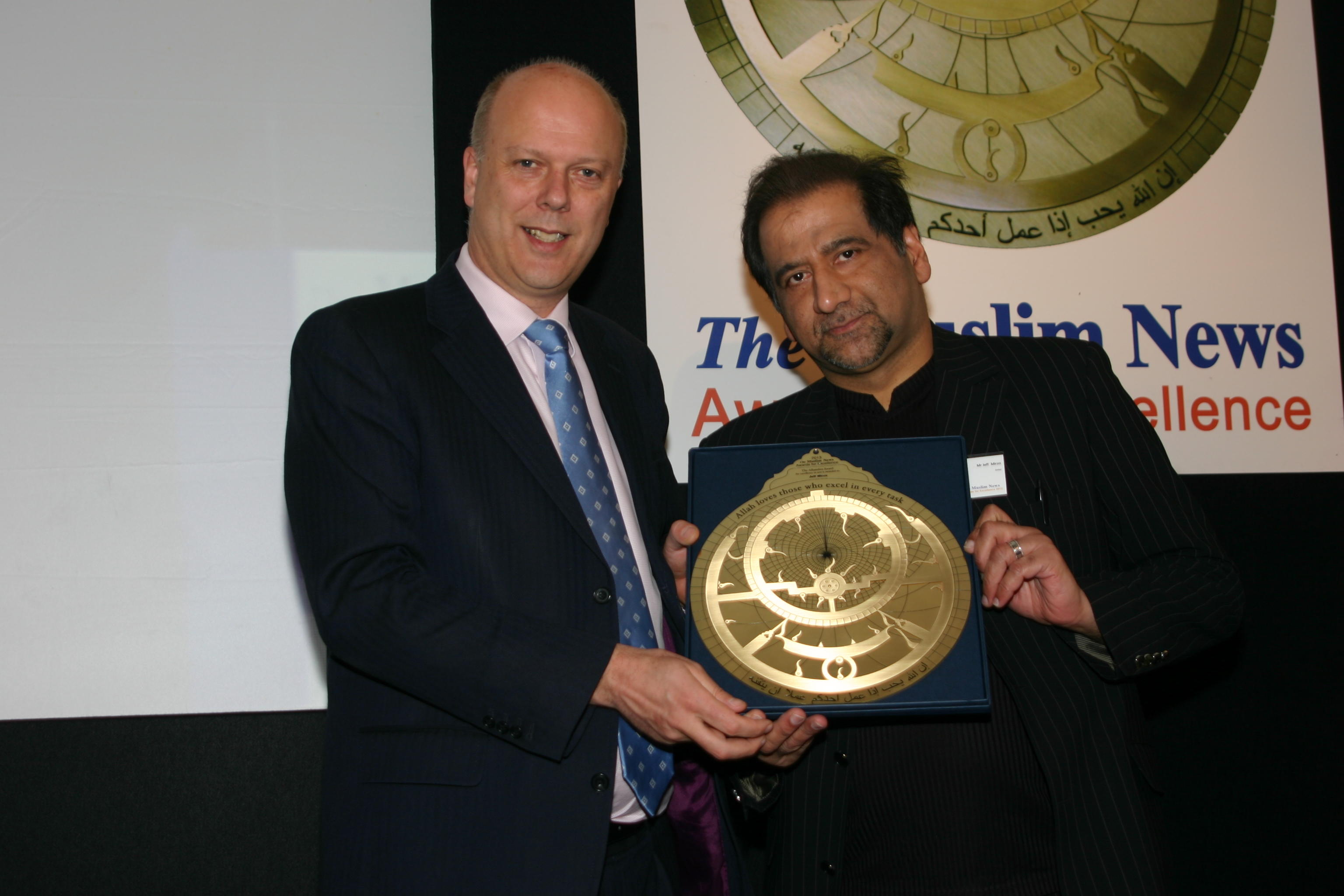 Uk muslims press for peace at 10 downing street - Justice Secretary Rt Hon Chris Grayling Mp Presenting Alhambra Arts Award To Comedian And Actor Jeff Mirza At The Muslim News Awards For Excellence Gala