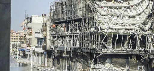 Syria: Suicide bombings kill dozens in Homs