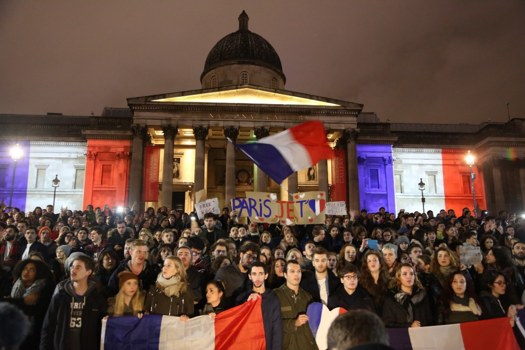 LONDON, ENGLAND - NOVEMBER 14: The National Portrait Gallery lit up in the colours of the French national flag during a vigil to pay respect to the victims of France terror attacks, at Trafalgar Square, London on November 14, 2015. At least 129 people were killed and 352 others injured -- 99 of them in critical condition -- after the terror attacks in Paris on 13 November. (Tayfun Salcı - Anadolu Agency)