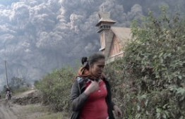 Indonesia: Two dead, flights disrupted as Indonesia volcano erupts