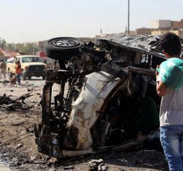 Iraq politician escapes attack, as a dozen car bombs kill 26 people