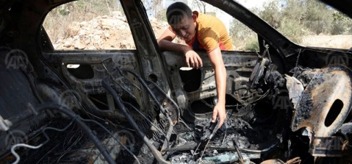 Palestine: Israeli settlers burn car & write racist graffiti